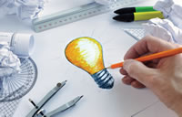 artist drawing a lightbulb